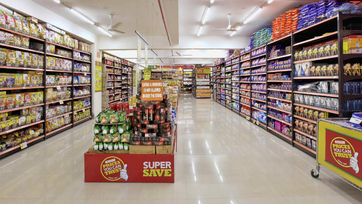 LED battens providing uniform lighting at isles within the supermarket