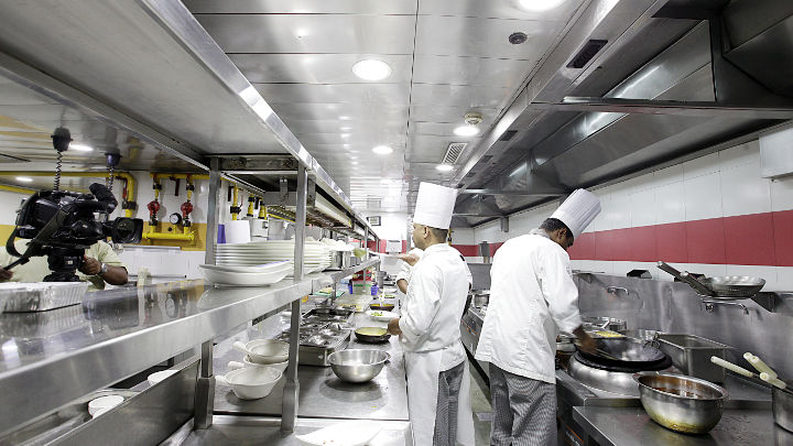 image restaurant kitchen lighting. philips led lights installed across cooking areas in the kitchen thas helped increase team productivity image restaurant lighting
